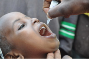 The oral polio vaccine is simple to administer. A few drops, given multiple times, can protect a child for life. (Photo: WHO/Rod Curtis)